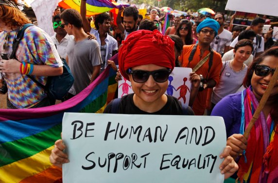 CORRECTS MONTH TO JUNE INSTEAD OF JULY - Activists of the Lesbian, Gay, Bisexual and Transgender (LGBT) rights and their supporters participate in a Rainbow Pride Rally in Chennai, India, Sunday, June 28, 2015. The participants also hailed the U.S. Supreme Court ruling, giving same-sex couples the right to marry in all 50 states. (AP Photo/Arun Sankar K)